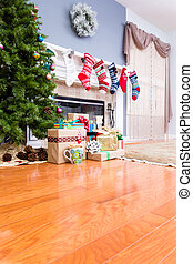 Decorated upmarket home at Christmas with colorful stockings...