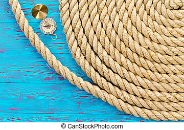 Neatly wound and coiled rope with compass