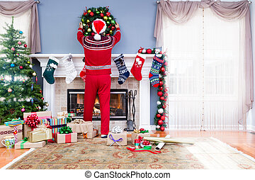 Man in Santa outfit decorating for Christmas