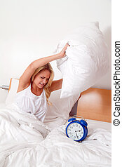 Wake up and stand up Alarm Clock Clock rings - Young woman...