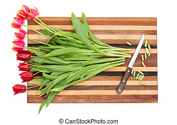 Trimming the stems of a bunch of red tulips - Trimming the...