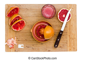 Juicing Ruby Red Grapefruit on Wood Board