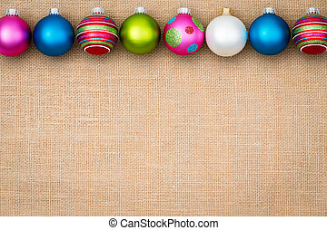 Festive Christmas bauble border on burlap