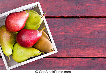Container with pears over table with copy space - Square...