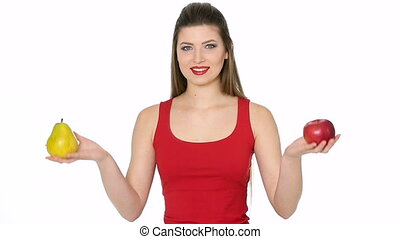 woman chooses between red Apple and pear on a white...