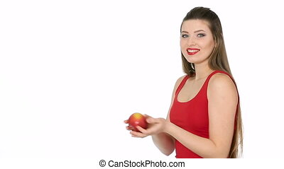 woman holding red Apple and smiling on white background -...