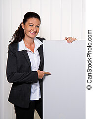 Successful young businesswoman with an empty poster - Young,...