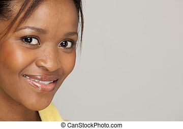 Happy South African Woman - Closeup image with copyspace of...