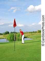 blonde girl playing golf
