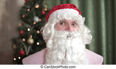 Closeup portrait of Santa Claus, Gesture of Silence new year, christmas