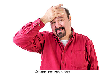 Distressed middle aged man with hand on forehead -...