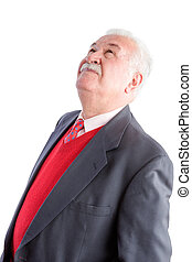 Close up of senior in business suit and red tie
