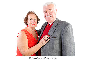 Lovely older woman places manicured hand on man as they both...