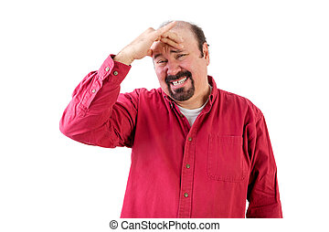 Middle aged man in distress with hand on forehead