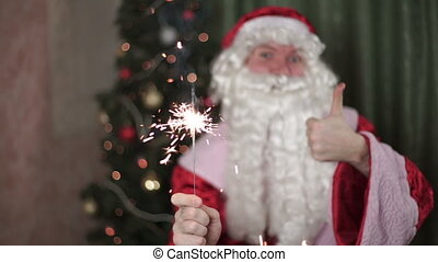 Closeup portrait of Santa Claus, sparkler in hand new year,...