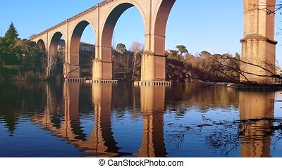 Reflection Of The Arch Bridge In The River - Water...