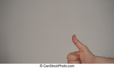 Man show thumbs up with his hand at plain background