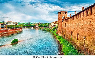 Bridge with archs Castelvecchio over river Adige in Verona...