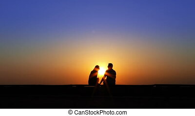 Couple Lovers in Sunset Silhouette