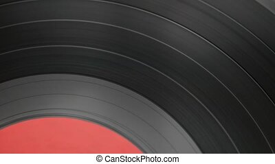 Closeup rotating vinyl record disc.