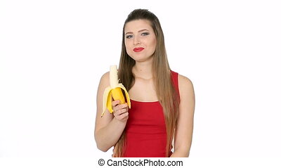 beautiful girl eats banana on white background - beautiful...