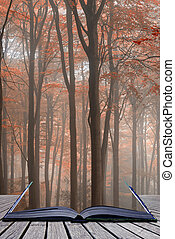 Stunning colorful vibrant evocative Autumn Fall foggy forest landscape coming out of pages of book