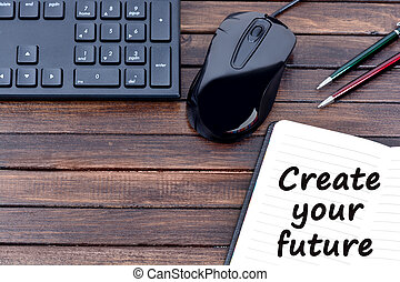 The words Create your future on notebook page