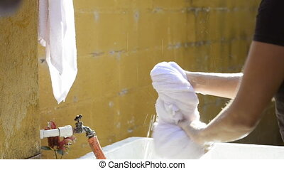 Woman Working In Outdoor Laundry - Woman working in an...