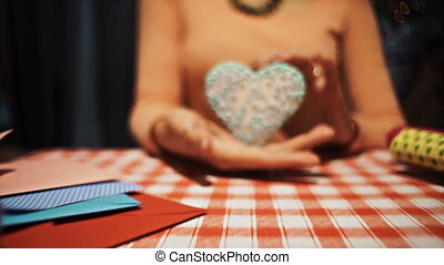 Close-up Female holding candy heart in her hands, sweet love symbol