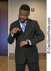 Man pointing at watch - Boss man telling someone theyre late...