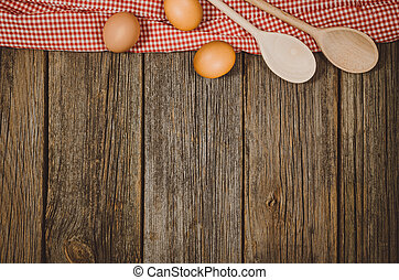 Baking or cooking ingredients top view on vintage wooden background