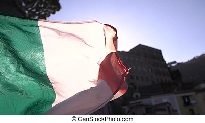 Waving Italian flag close up.
