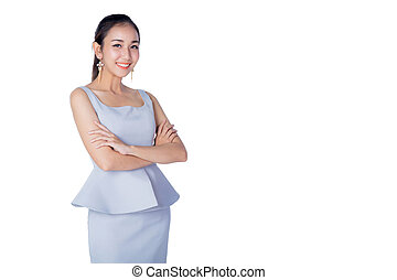 Smiling business woman standing against white background with crossed arms.