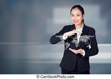 Young Asian businesswoman holding a globe with social...