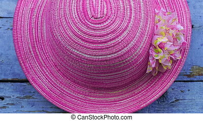 pink hat hanging on wooden wall background. - pink hat...