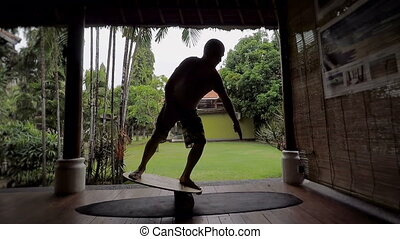 Island of Bali. The young guy trains on specially balance...
