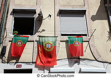 Portuguese Flags at a house in Lisbon, Portugal