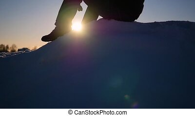 the guy sitting high on a snow slope. snow winter landscape. outdoors sports