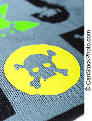 Fabric with skulls and bones .