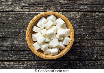 White sugar cubes. - White sugar cubes in bowl.