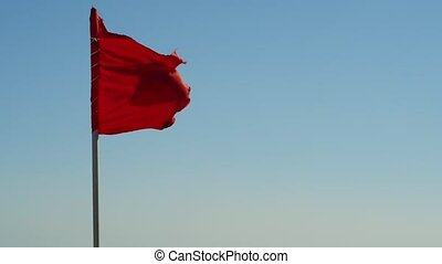 red flag at sea. Swimming is prohibited.