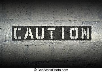 caution word gr - caution stencil print on the grunge white...