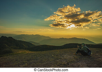 trekking woman relaxing on top of mountain against beautiful...