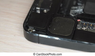 Dismantling a broken mobile phone - Repairman disassemble...