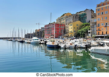 Bastia in Corsica - colorful city in front of a marina in...