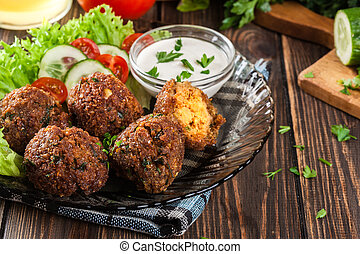 Chickpea falafel balls with vegetables - Chickpea falafel...