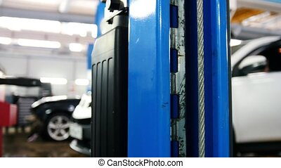 Blue car lift - automobile service, slider