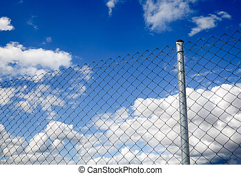 Fence and sky - Suggestive image of metal fence against the...