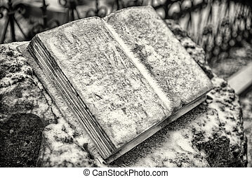 Open stone book with snow on it