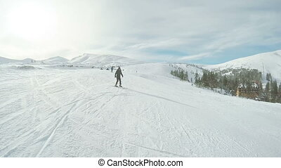 Ski descent in nature - Riding on skis man down road